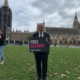 Bambos in Parliament Square for the Free Nazanin campaign with Amnesty UK